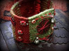 Tribal gypsy embellished woven cuff - the coin. $40.00, via Etsy.