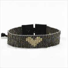 A heart woven pattern is the main focus in this design, which wraps around a woman's wrist one time....