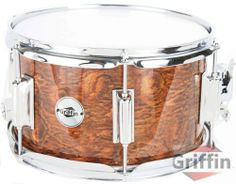"""Griffin Popcorn Snare Drum 10"""" x 6"""" Dark Wood Shell Firecracker Soprano Percussion Poplar by Griffin Stands. $38.95. Featured here is a natural wood finish popcorn snare drum by Griffin. Are you looking to add an extra snap, crackle or pop to your drum kit? Then you're looking for this natural finish Popcorn snare drum! Also known as firecracker snare drums or soprano snare drums, these 10 inch diameter snare drums feature a higher tone than regular snare drums or piccolo snar..."""