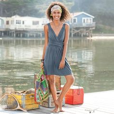 "BOARDWALK DRESS -- Easy popover to shelter your swimsuit or stroll the shore. Soft jersey knit with surplice neck, draped waist and deep scoop pockets, above knee length. Rayon/spandex. Machine wash. Imported. Sizes S (4 to 6), M (8 to 10), L (12 to 14), XL (16). Approx. 34-1/2""L."