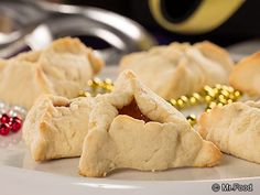 Triangle Hat Cookies - Traditionally known as Hamantashen, these jam-filled cookies are eaten to celebrate the Jewish holiday of Purim.