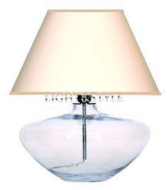 Zumaline LAMPA STOŁOWA MADRID 4CONCEPTS. Lampa stołowa renomowanej firmy 4Concepts. Podstawa lampy wykonana ze szkła bezbarwnego. Gniazdo żarówki oraz wewnętrzna rurka prowadząca przewód ze stali nierdzewnej. Przewód pvc bezbarwny z przełącznikiem i wtyczką. Abażur wykonany z materiału podklejanego pvc zapewniający przenikanie światła.