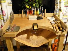 I like this example of custom made jewellery bench (and the lemon tree outside the window)