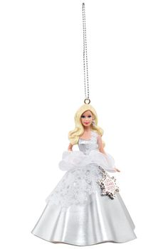 2013 Holiday Barbie Ornament -   Shimmering in silver and a shower of intricate snowflakes, this ornament is the first in a new series of ornaments by American Greetings. A tiny snowflake charm, commemorating the 25th Anniversary of Holiday Barbie™ doll, dangles from her white tulle overskirt.