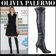 Olivia Palermo in black leather thigh boots and black sleeveless coat