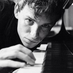 Eddie Redmayne. I like this photo of him, it's like I'm right next to him and he's teaching me piano