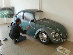 """This """"artist"""", seems to like Volkswagen, this was at the Car Part art exhibit at The Hub, on Main Street. Yesterday at The Art Walk http://scvartwalk.org/ , a sawed-in-half 1960′s VW Bug. The VW Bug was cut in half and painted by local artist, Steve Jasik. — in Newhall."""