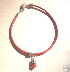 Red charm bracelet for luck and protection