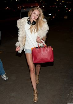 Candice Swanepoel wearing Dries Van Noten Snake Print Ankle Boot and Burberry Prorsum Shearling and Wool Jacket.