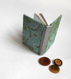 Minibooks 2013 on Behance Mini green and silver book 5 cm X 6,5 cm