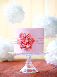 Patel pink cake embellished with rose inspired swirls. Made using the range from @wilton! Shop now at C+C: http://www.createandcraft.tv/wilton #cakedecorating