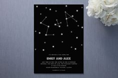 It's in the Stars - use black, silver and white theme and then do silver stars on tables as confetti, cake in white with black or silver accent, do neat candles on tables with epsom salt holders