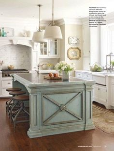 Sweetness and light. Love the look of a painted island in a gorgeous neutral kitchen like this. Try: Benjamin Moore Sylvan Mist http://www.myperfectcolor.com/en/color/378934_Benjamin-Moore-CSP-740-sylvan-mist for a smokey blue accent.