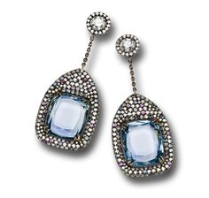 Rectangle Burma unheated sapphires micro-set with sapphires and diamonds.