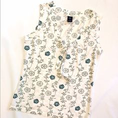 White Gap floral motif tank Medium size Gap tank top with gray and green floral motif. Tie at neck. Excellent condition. GAP Tops Tank Tops