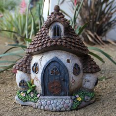Solar Miniature Garden Cottage by Exhart Gift & Garden. The details are hand-painted and realistic. Get it at Exhart Gift & Garden