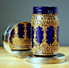 Hand Painted Mason Jar Lantern,Deep Plum Tinted Glass with Golden Filigree Surface. $24.00, via Etsy.