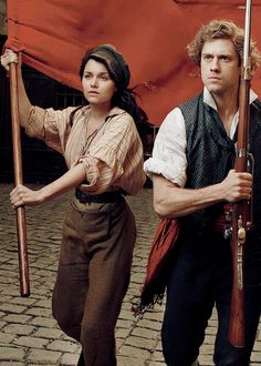 Enjonine. (Enjolras and Eponine, Les Miserables). I dare you to show me another ship that is further from canon, and yet, it demands to be shipped. And not just shipped, but shipped with priority shipping.