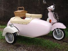 A pink Vespa with a sidecar.. perfect