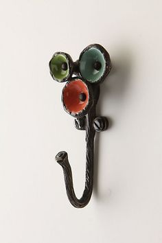 Smaller, unique cast iron hooks that aren't black and boring.  Found at Anthropologie and are now being useful around our house.  'Melded Poppies Hook'