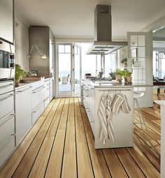 great kitchen but not those floors - love being able to close it off from rest of the house if necessary w/glass/french doors