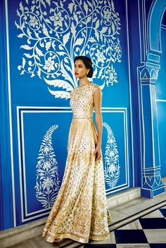 ThePoetic silk gota pattigown is a testament to the variety and quality of craftsmanship prevalent in India. It is an exquisite white gown with intricate gota patti, makes it a perfect mix of ethnicity and modern touch.