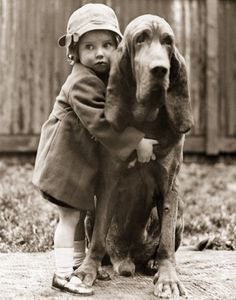 Cute little girl with her hound dog..
