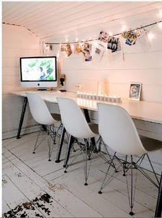 white office corner.                                      Love the string of lights suspended for hanging pictures, ideas etc ~ a possible alternative to a mood board...