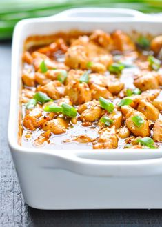 Dump dinners are a genius way to make feeding your family easy-peasy! This Dump-and-Bake General Tso's Chicken is basically takeout at home with a healthier twist. Flavor your chicken bites with hoisin sauce, sesame oil, ginger, red pepper flakes, and peanuts. | recipe from The Seasoned Mom