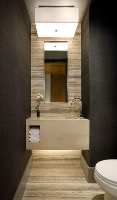 Very cool floating mitered vanity top against Silver Travertine Slabs on wall and Floor!