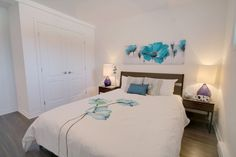 Blue and white bedroom staged for Le Desaulniers condos - basement bedroom with blue accents