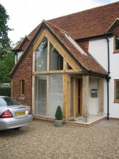 Oak and clay tile entrance, by Roderick James Architects