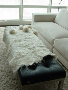 Natural cream wool felt throw with pom poms. modern fiber lab.