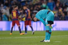 Arsenal's Colombian goalkeeper David Ospina adjusts his stockings after Barcelona's goal during the UEFA Champions League Round of 16 second leg football match FC Barcelona vs Arsenal FC at the Camp Nou stadium in Barcelona on March 16, 2016.
