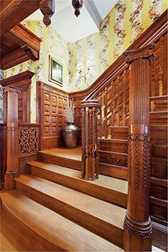 This is the grand staircase, with its original oak stairs, banisters, and paneled wainscoting. The pillars at the base were originally designed to hold gas lanterns.  This is a record-setting elevator mansion in NYC. Price: $29,000,000. 24 West 71st Street is a one-of-a-kind parlour floor and elaborately decorated façade. Featured in THE NEW YORK TIMES. Townhouses for Sale in New York City, NY by Vandenberg Inc. #townhouse #brownstone #mansion #nyc #realestate
