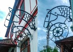 Forged store sign