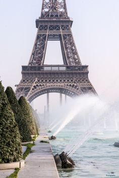Eiffel with fountains and reflecting pool in foreground