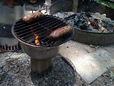 Solo Stove Titan with Grill Bowl roasting some fresh sausages.