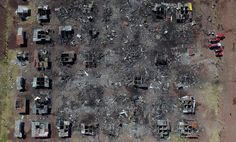 Aerial view of Mexico's biggest fireworks market in Tultepec suburb, Mexico State, after a massive explosion killed at least 32 people on December 21, 2016. Mexico worked Wednesday to identify charred bodies left by an explosion at its biggest fireworks market, as authorities investigated what caused the multi-colored salvo of destruction
