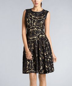 Cutouts decorate this belted beauty for a vintage throwback. Boasting sumptuously silky fabric with satin trim around the neckline and shoulders, this feminine frock radiates romantic allure.
