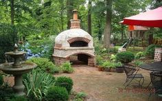 Round pizza oven made of recycled bricks in Greensboro, NC.  'This oven is so well insulated that the owner says he can have 'a roaring fire for over 3 hours at over 1000 degrees inside and yet the outside brick surface temps are less than 90 degrees, which is what the air temp is during the day outside.