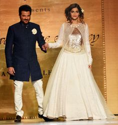 Anil Kapoor wore a navy blue achkan as he poses with his princess daughter Sonam Kapoor at Shabana Azmi's fashion show 'Mijwan'.