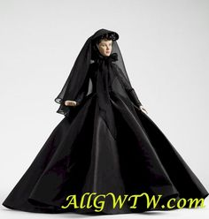 Mrs. Charles Hamilton *Retired* Tonner Doll - This beautiful Mrs. Charles Hamilton Scarlett O'Hara Tonner Doll was released in 2011 and is tired. Scarlett wears a black mourning gown, gloves petticoat, pantyhose and faux-leather pumps. A detailed veiled hat completes her ensemble.