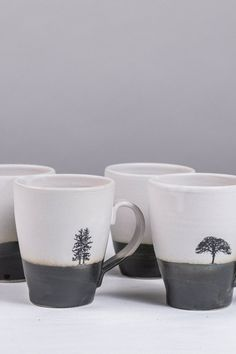 We found your new favorite coffee mugs. Black and white tall ceramic mugs with unique black tree decals are the perfect simple, go-to mug for your favorite morning beverage.