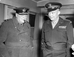 14th November 1944: British prime minister Winston Churchill smokes a cigar and listens while General Dwight D. Eisenhower, Supreme Allied Commander, shows him his trailer, World War II.