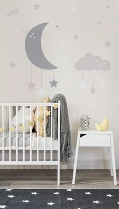 In love with the soft neutrals in this modern nursery space. Both charming and calming, this nursery mural features a crescent and cloud mobiles. The simplicity of the colour palette make it perfect for gender neutral nurseries. - Home Decor Max Clouds Nursery, Star Nursery, Moon Nursery, Nursery Murals, Box Room Nursery, Star Themed Nursery, Childrens Wall Murals, Cloud Nursery Decor, Nursery Chairs