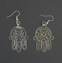 Hey, I found this really awesome Etsy listing at https://www.etsy.com/listing/213551562/moroccan-hamsa-earrings-african-silver