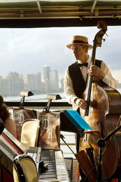 LivingSocial Adventures partnered with HBO to throw a fun, lavish night out on a yacht to celebrate Season 2 of Boardwalk Empire. GigMaster's member The Different Hats Orchestra completed the 1920's theme. This is a great picture with the cello and piano and city in the background. 1920s Theme, Boardwalk Empire, Popular Music, Cello, Great Pictures, Orchestra, Season 2, Piano, Night Out