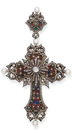 AN ANTIQUE ENAMEL, DIAMOND AND PEARL CROSS PENDANT, BY BOUCHERON The ornate cross of green, blue and red enamel, diamond scroll and collet detail