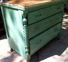 This is an antique dresser that has been refinished and resurfaced with an oak butcher butcher block top to be used as a kitchen island.